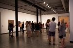 Patrons enjoying Tony de los Reyes exhibition.