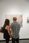 Patrons enjoying Erin Morrison exhibition.