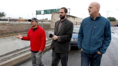 Vinct and Juan walking along freeway